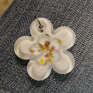 Fliower shaped pendant.